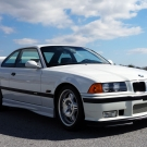 Lovely front view of BMW E36 running on road while testing