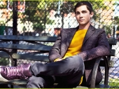 Actor Logan Lerman getting rest on beanch in park